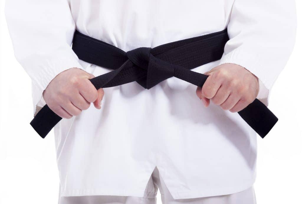 person straightening their blackbelt