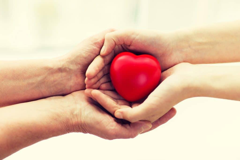 seniors hands around a hearth - heart health