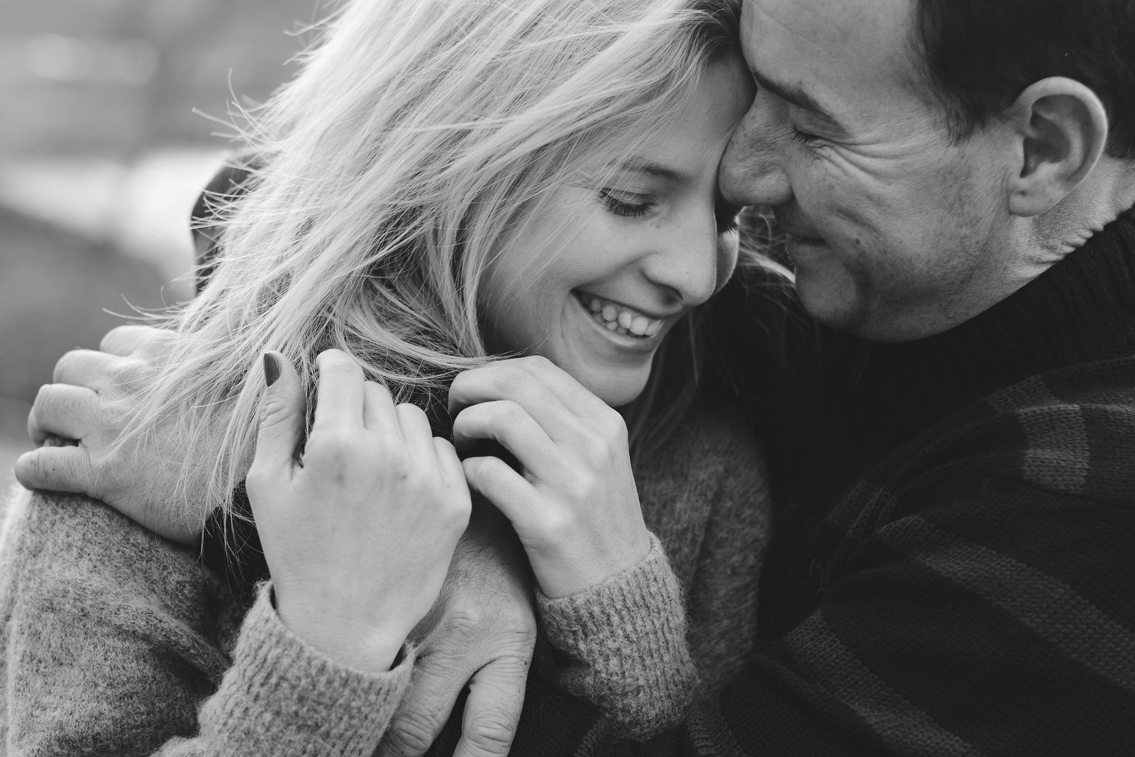 Young couple in love hug each other. Smiling couple in love outdoors. Couple face to face on Valentine's Day