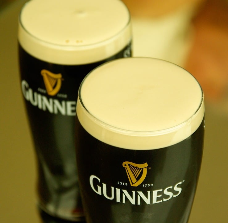 two glasses of guinness beer