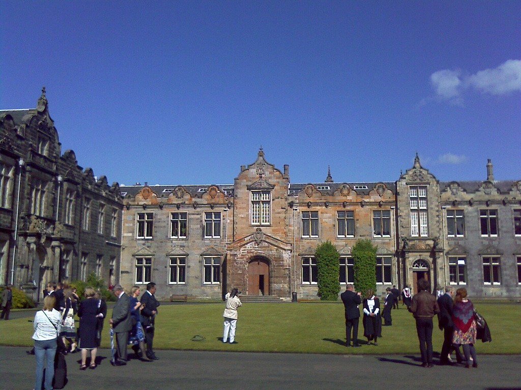 student, parents and teachers in the premises of st. andrews university