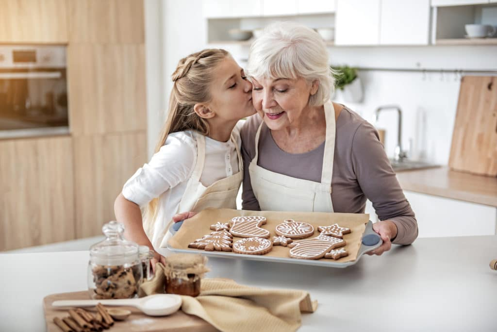 Grandma baking with grandchild