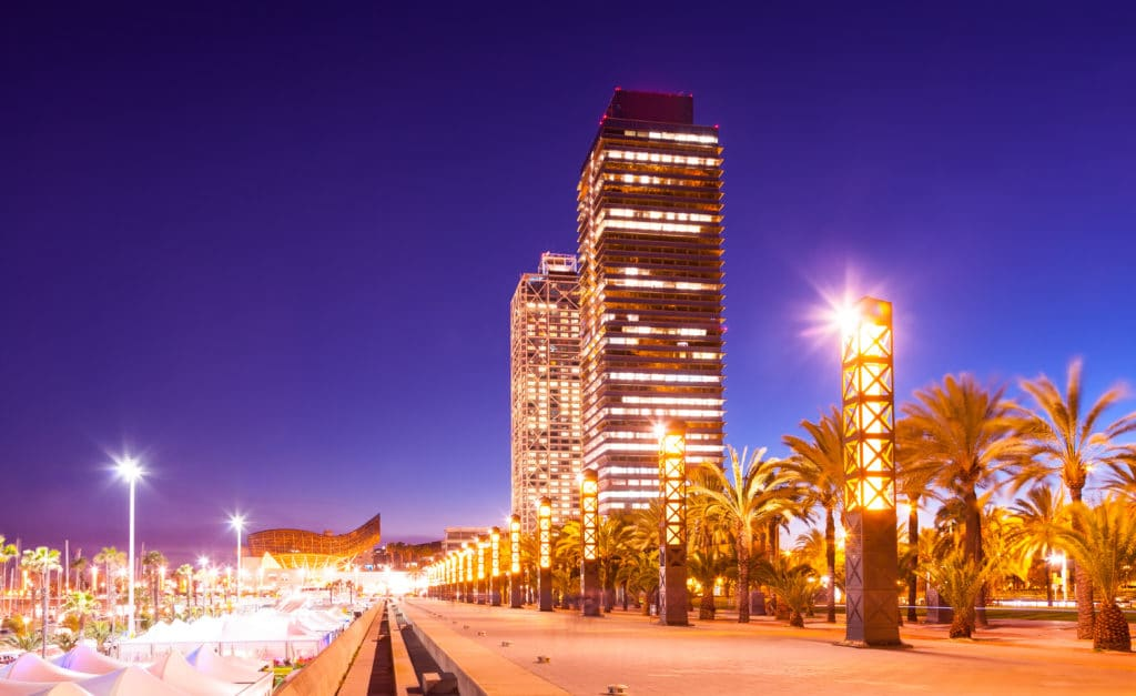 night view of skyscrapers in Port Olimpic - center of nightlife at Barcelona