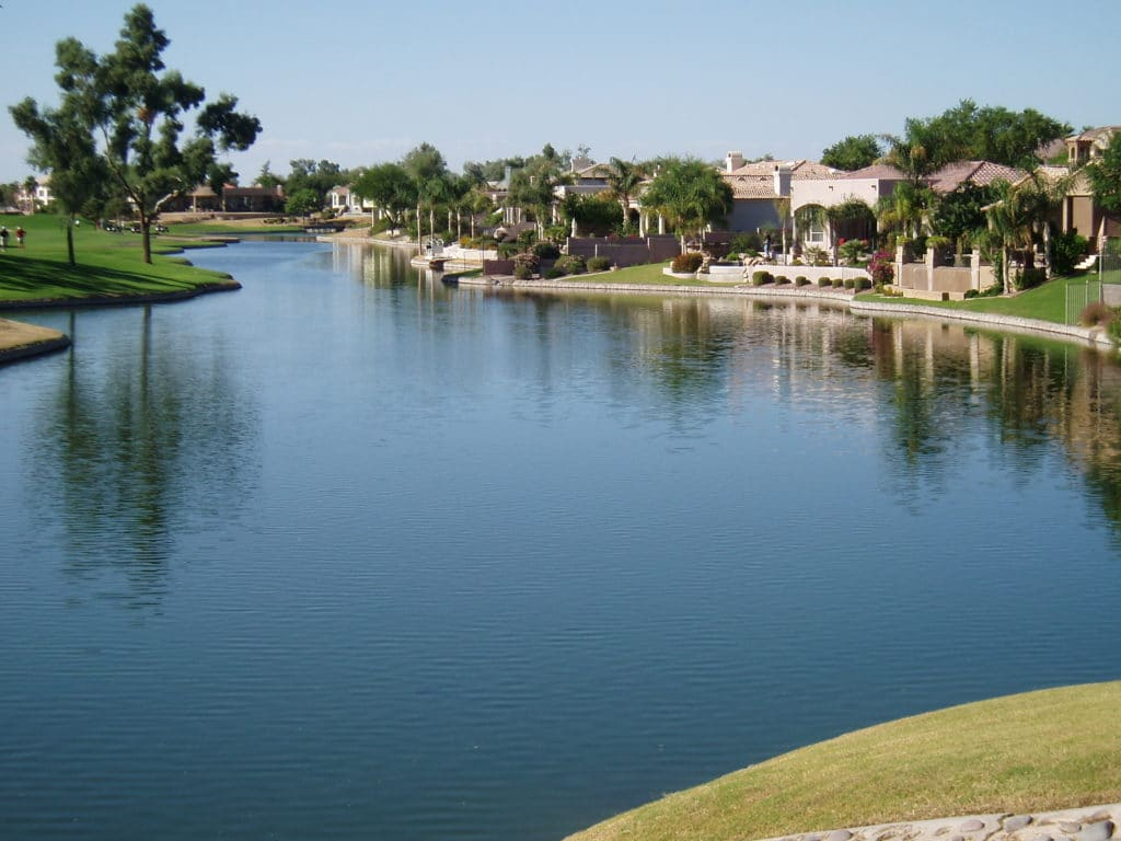 Homes on a beautiful blue lake in a golf course community.