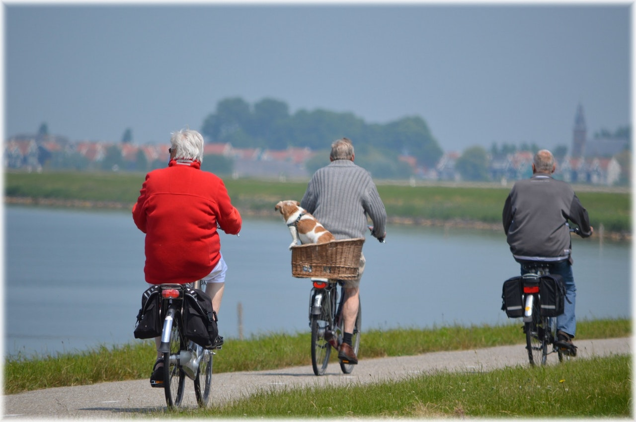 elderly people biking to overcome loneliness in old age