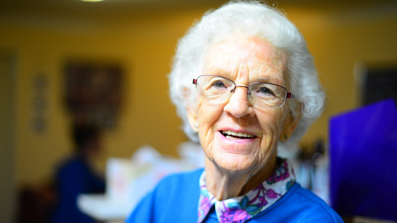 old woman smiling to illustrate part time jobs for people over fifty